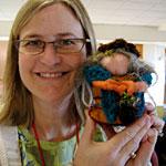 brigitta with her woven doll, the third Weaving a Life keyform